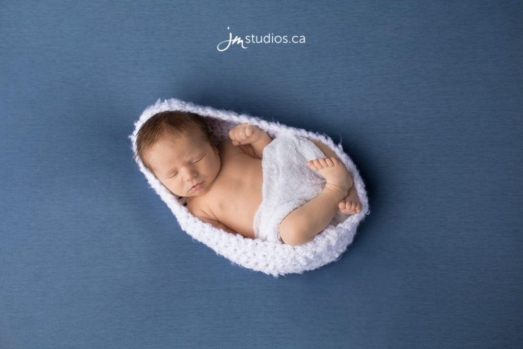 Perrin's #Newborn Session at our Calgary based studio. Congratulations to his parents Stephanie and Michael. #NewbornPhotos by Calgary Newborn Photographer JM Photography © 2017 http://www.JMstudios.ca #JMportraits #JMstudios #JMphotography #JMnewborns #NewbornPhotography #CalgaryMoms #PreciousMemories #CuteBabies